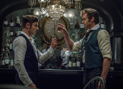 Zac Efron and Hugh Jackman star in THE GREATEST SHOWMAN .