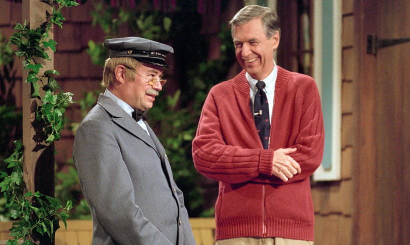 Fred Rogers and David Newell in costume on porch set of Mister R